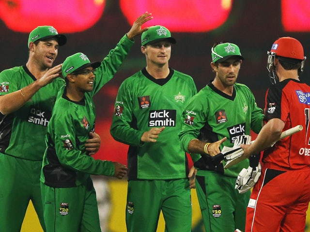John Hastings, Clive Rose, Jackson Bird and Glenn Maxwell of the Stars celebrate their win next to Aaron O'Brien of the Renegades during the Big Bash League match between the Melbourne Stars and the Melbourne Renegades at Melbourne Cricket Ground on Decem