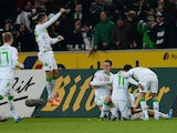 Moenchengladbach's players celebrate during the German first division Bundesliga football match Borussia Moenchengladbach vs VfL Wolfsburg in the German city of Moenchengladbach on December 22, 2013