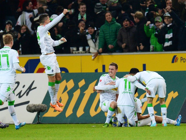 Moenchengladbach's players celebrate during the German first division Bundesliga football match Borussia Moenchengladbach vs VfL Wolfsburg in the German city of Moenchengladbach on December 22, 2013