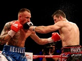 Carl Froch of England in action with Mikkel Kessler of Denmark during their Super Middleweight Unification bout at the O2 Arena on May 25, 2013