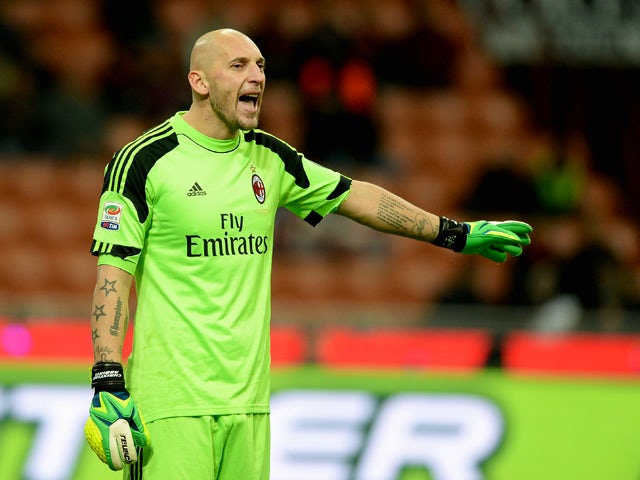 Christian Abbiati of AC Milan reacts during the Serie A match between AC Milan and Genoa CFC at Stadio Giuseppe Meazza on November 23, 2013