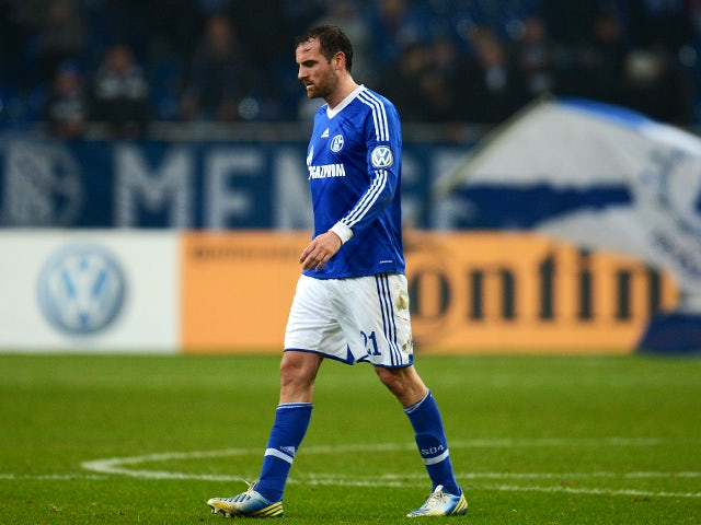 Schalke's defender Christoph Metzelder reacts after the German Cup football match Schalke 04 vs FSV Mainz 05 in Gelsenkirchen, western Germany, on December 18, 2012