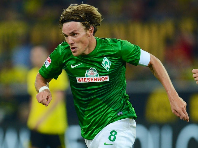 Werder Bremen's defender Clemens Fritz playing the ball during the German first division Bundesliga football match against Borussia Dortmund on August 24, 2012