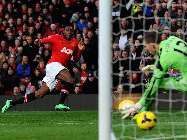 Manchester United's English striker Danny Welbeck scores the opening goal past West Ham United's Spanish goalkeeper Adrian during the English Premier League football match on December 21, 2013