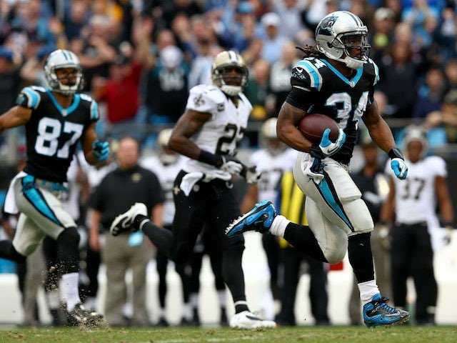 DeAngelo Williams of the Carolina Panthers runs for a touchdown during their game against the New Orleans Saints at Bank of America Stadium on December 22, 2013
