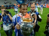 Didier Drogba poses with the Champions League trophy on May 19, 2012.