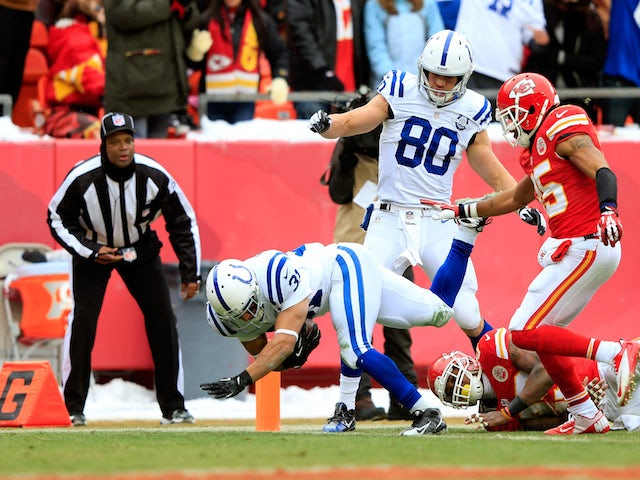 Running back Donald Brown of the Indianapolis Colts dives across the goal line for a touchdown during the 1st half of the game against the Kansas City Chiefs on December 22, 2013