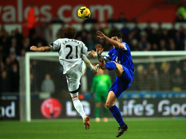 Jose Alberto Canas of Swansea and Gareth Barry of Everton compete for the ball during the Barclays Premier League match between Swansea City and Everton at the Liberty Stadium on December 22, 2013