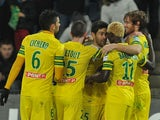 Nantes' Fernando Aristeguieta celebrates with teammates after scoring the opening goal against Auxerre during their French League Cup match on December 17, 2013