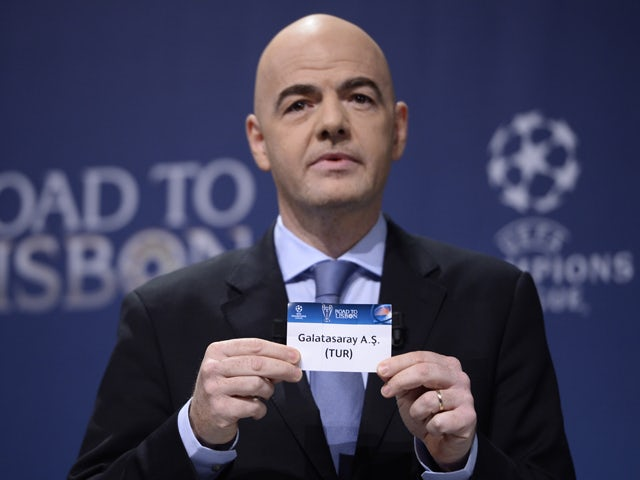UEFA general secretary Gianni Infantino holds up the name of Turkish club Galatasaray during the draw for the last 16 of the UEFA Champions league tournament at the UEFA headquarters in Nyon on December 16, 2013