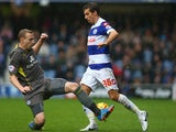 Gary O'Neil of Queens Park Rangers battles for the ball with Ritchie De Laet of Leicester City during the Sky Bet Championship match on December 21, 2013