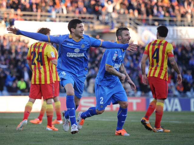 Lisandro Lopez of Getafe CF celebrates after scoring Getafe's 2nd goal during the La Liga match between Getafe CF and FC Barcelona at Coliseum Alfonso Perez on December 22, 2013