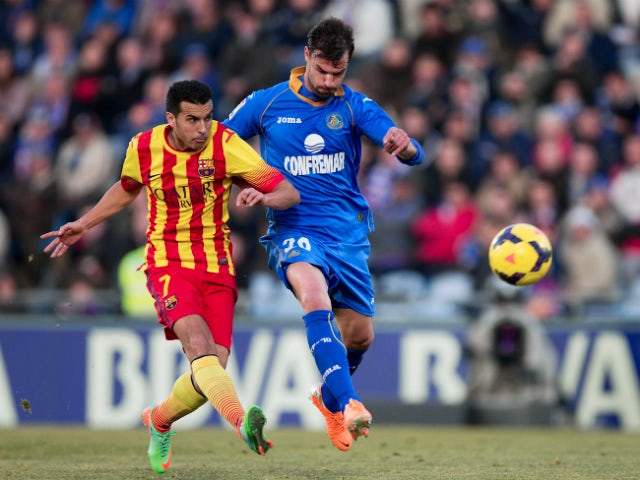 Pedro Rodriguez Ledesma of FC Barcelona scores their opening goal against Juan Valera Espin of Getafe CF during the La Liga match between Getafe CF and FC Barcelona at Coliseum Alfonso Perez on December 22, 2013