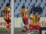 Barcelona's forward Pedro Rodriguez celebrates with teammates after scoring during the Spanish league football match Getafe CF vs FC Barcelona at the Alfonso Perez Coliseum in Getafe on December 22, 2013