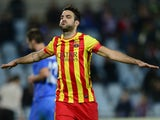 Barcelona's midfielder Cesc Fabregas celebrates after scoring their fifth goal during the Spanish league football match Getafe vs Barcelona at Coliseum Alfonso Perez stadium in Getafe near Madrid on December 22, 2013