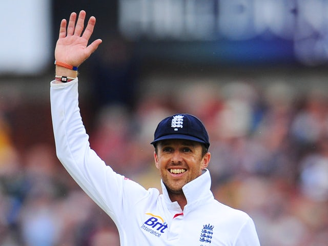 Graeme Swann of England waves in the field during day four of the 3rd Investec Ashes Test match between England and Australia at Emirates Old Trafford Cricket Ground on August 4, 2013