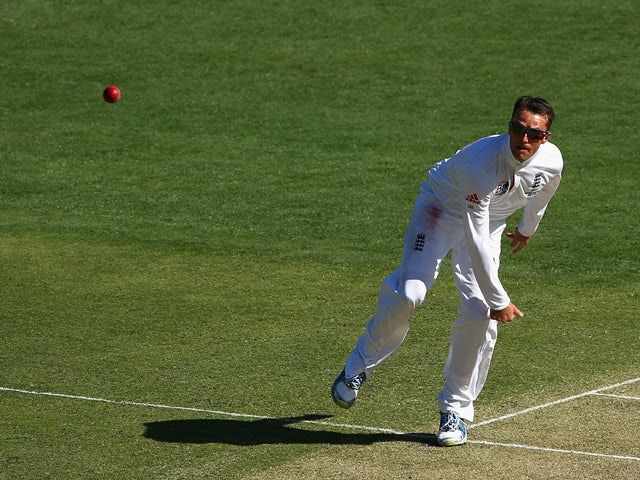 Graeme Swann of England bowls during day one of the First Ashes Test match between Australia and England at The Gabba on November 21, 2013