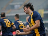Luca Toni of Hellas Verona FC celebrates after scoring the opening goal during the Serie A match between Hellas Verona FC and SS Lazio at Stadio Marc'Antonio Bentegodi on December 22, 2013