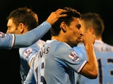 Jesus Navas of Manchester City celebrates scoring their third goal during the Barclays Premier League match between Fulham and Manchester City at Craven Cottage on December 21, 2013