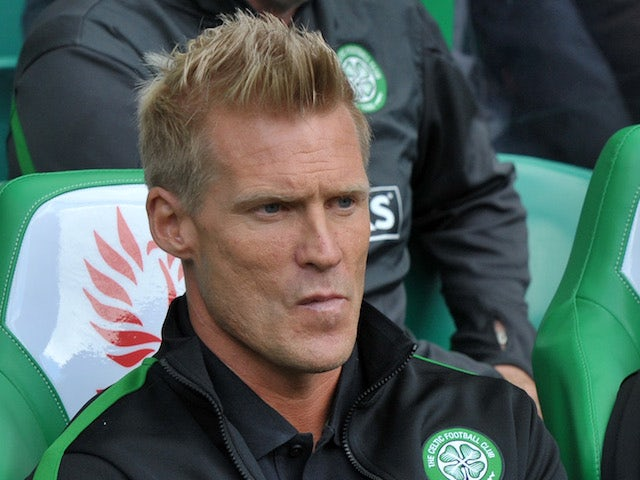 Celtic number two Johan Mjallby in the dugout on August 3, 2013