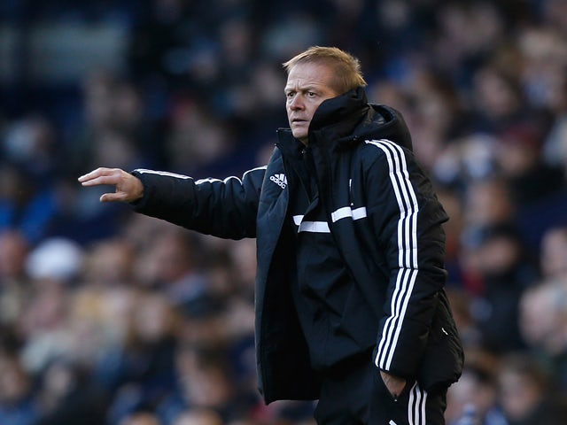 West Brom assistant head coach Keith Downing gestures during the Barclays Premier League match between West Bromwich Albion and Crystal Palace at The Hawthorns on November 2, 2013