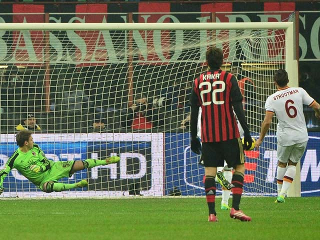 Roma's Kevin Strootman scores his team's second goal via the penalty spot against AC Milan during their Serie A match on December 16, 2013