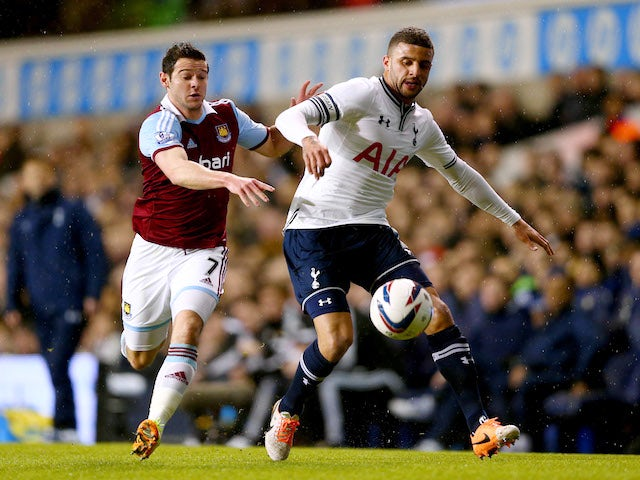Kyle Walker of Tottenham Hotspur holds off Matthew Jarvis of West Ham United during the Capital One Cup Quarter-Final match on December 18, 2013