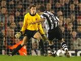 Laurent Robert scores Newcastle United's third goal against Arsenal on December 18, 2001.