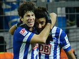 Hertha's Georgian defender Levan Kobiashvili and Hertha's Tunisian forward Sami Allagui celebrate during the German first division Bundesliga football match against Borussia Dortmund on December 21, 2013