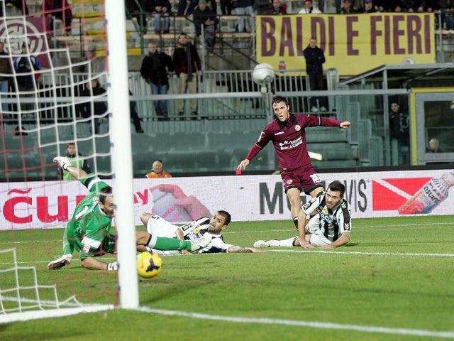 Luca Siligardi of AS Livorno Calcio scores a goal during the Serie A match between AS Livorno Calcio and Udinese Calcio at Stadio Armando Picchi on December 22, 2013