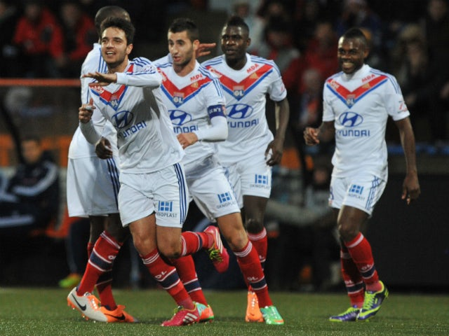 Lyon's French midfielder Clement Grenier celebrates with teammates after scoring during the French L1 football match between Lorient and Lyon on December 22, 2013