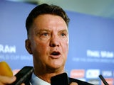Netherlands coach Louis van Gaal speaks to members of the media after the Final Draw for the 2014 FIFA World Cup Brazil at Costa do Sauipe Resort on December 6, 2013