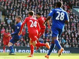 Luis Suarez of Liverpool shoots and scores during the Barclays Premier League match between Liverpool and Cardiff City at Anfield on December 21, 2013