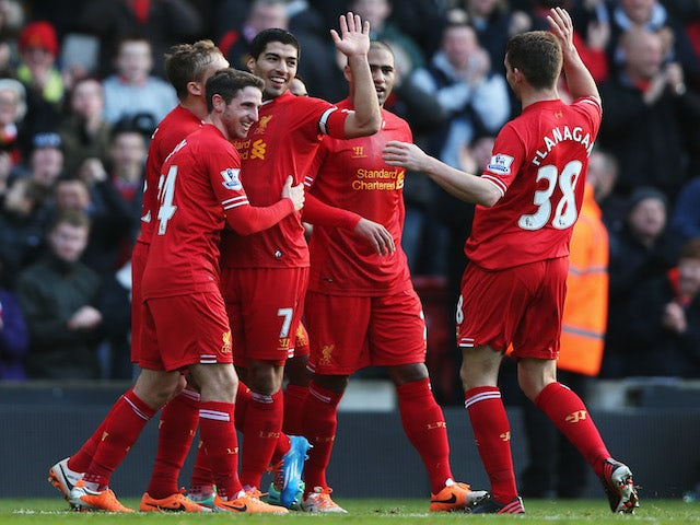 Luis Suarez of Liverpool celebrates with team mates after scoring during the Barclays Premier League match against Cardiff City on December 21, 2013