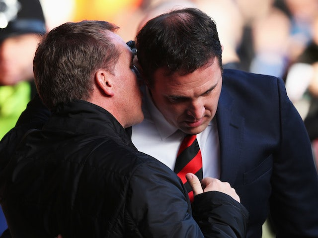 Cardiff City manager Malky Mackay talks with Liverpool manager Brendan Rogers before the Barclays Premier League match on December 21, 2013