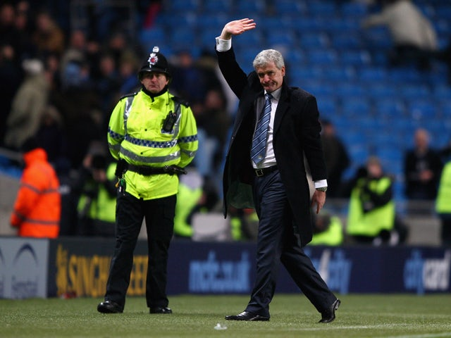 Manchester City manager Mark Hughes waves to the crowd after the Barclays Premier League match between Manchester City and Sunderland at the City of Manchester Stadium on December 19, 2009