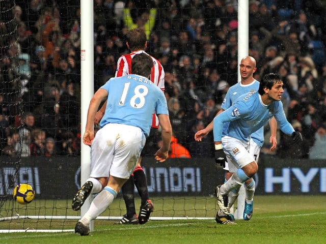 Manchester City's Paraguayan striker Roque Santa Cruz celebrates his goal during the English Premier League football match between Manchester City and Sunderland at the City Of Manchester Stadium in Manchester, north-west England on December 19, 2009
