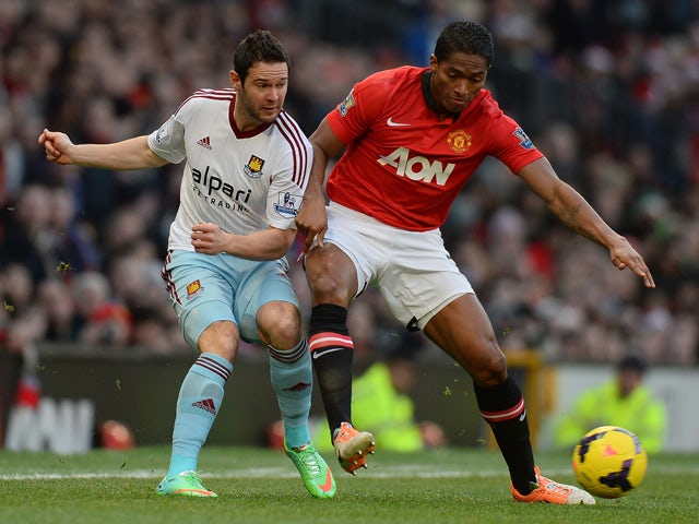 Manchester United's Ecuadorian midfielder Antonio Valencia vies with West Ham United's English midfielder Matt Jarvis during the English Premier League football match between Manchester United and West Ham United at Old Trafford, Manchester, northwest Eng
