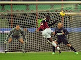 AC Milan's forward Mario Balotelli kicks the ball during the Italian Serie A football match Inter Milan vs AC Milan at San Siro Stadium in Milan on December 22, 2013
