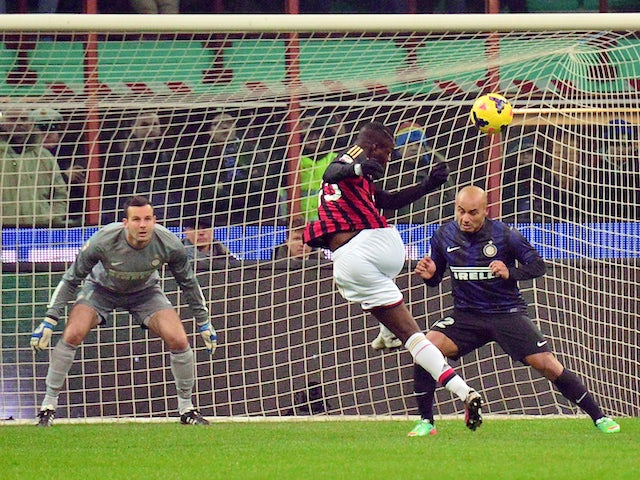 AC Milan's forward Mario Balotelli kicks the ball during the Italian Serie A football match Inter Milan vs AC Milan at San Siro Stadium in Milan on December 22, 2013