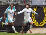 Marseille's French forward Andre-Pierre Gignac celebrates after scoring during the French L1 football match Olympique de Marseille vs Bordeaux on December 22, 2013