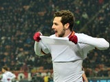 Roma's Mattia Destro celebrates after scoring the opening goal against AC Milan during their Serie A match on December 16, 2013