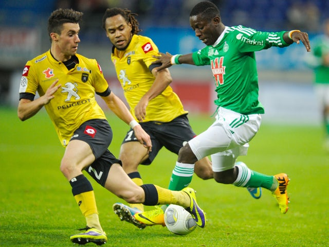 Saint Etienne's Ivorian forward Max-Alain Gradel vies for the ball with Sochaux's French defender Sebastien Corchia and Sochaux's French forward Roy Contout during the French L1 football match Reims vs Bastia on November 2, 2013