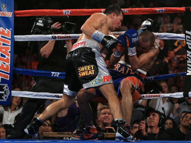 Ruslan Provodnikov of Russia knocks down Mike Alvarado on the ropes in the eighth round at the 1stBank Center on October 19, 2013