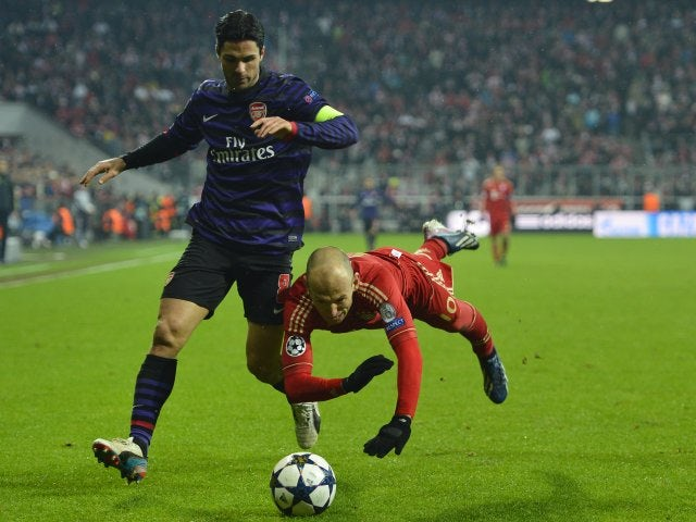Mikel Arteta and Arjen Robben battle for possession in the Allianz Arena on March 15, 2013.