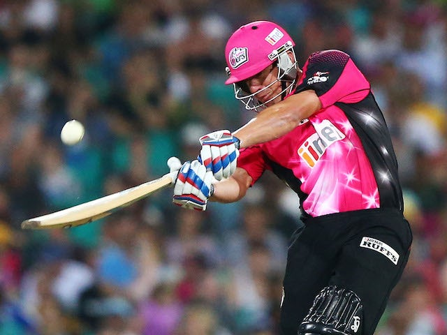 Moises Henriques of the Sixers hits for six during the Big Bash League match between the Sydney Sixers and Sydney Thunder at SCG on December 21, 2013