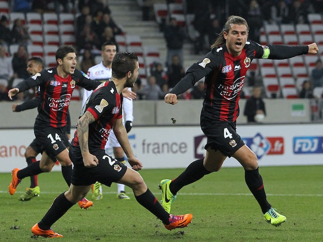 Nice's Serbia defender and captain Nemanja Pejcinovic celebrates after scoring a goal during the French Ligue Cup football match between Nice (OGCN) and Sochaux (FCSM), on December 18, 2013