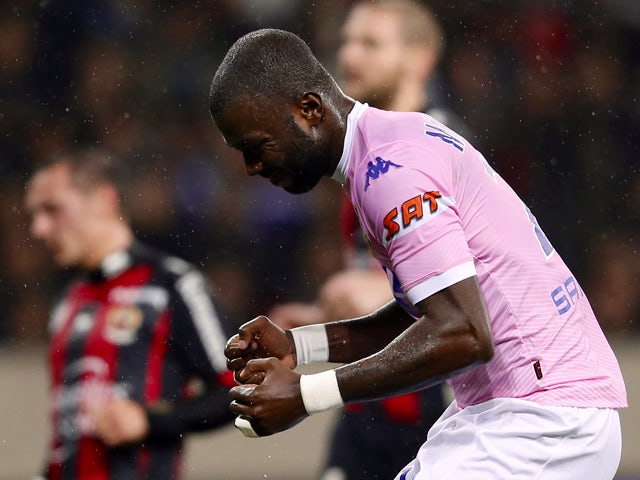 Evian's Congolese defender Cedric Mongongu celebrates after scoring a goal during the French L1 football match Nice (OGC Nice) vs Evian (ETGFC) on December 21, 2013