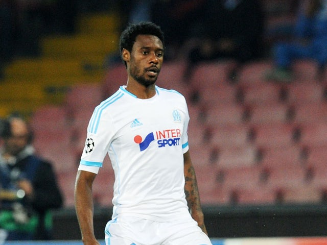 Nicolas N'Koulou of Olympique de Marseille in action during the UEFA Champions League Group F match between SSC Napoli and Olympique de Marseille at Stadio San Paolo on November 6, 2013