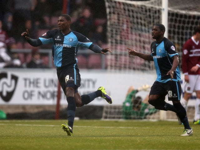 Kortney Hause of Wycombe Wanderers celebrates after scoring his sides second goal during the Sky Bet League Two match between Northampton Town and Wycombe Wanderers at Sixfields Stadium on December 21, 2013